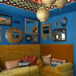 Brilliant-Moroccan-Lamps-Over-Brown-L-Shaped-Couch-And-Patterned-Rug-Combined-With-Mirrors-Mounted-To-Blue-Wall-Completed-With-Eclectic-Ceiling-And-Wood-Floor
